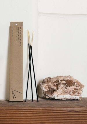 candle incense sticks on shelf