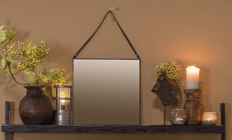 mom blue leather mirror on shelf with a vase and candle