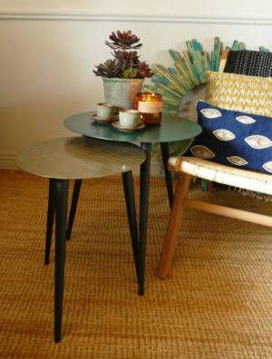 wako side tables in green with cups and candles from stagers lifestyle