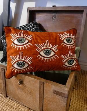 Burnt Orange Eye Cushion on teak box