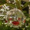 GLAM FACE TREE BAUBLE HANGING ON TREE