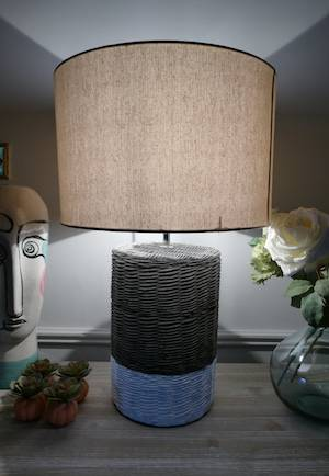 CERAMIC BASKET LAMP WITH SHADE ON TABLE