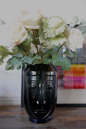 ABSTRACT FACE VASE WITH FLORAL STEMS