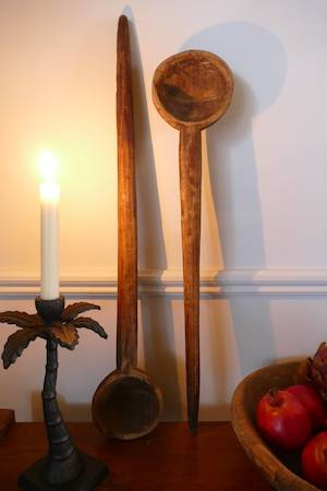 DECORATIVE WOODEN SPOON AGAINST WALL