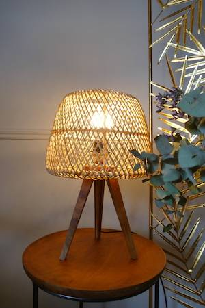 RATTAN TRIPOD LAMP ON TEAK TABLE